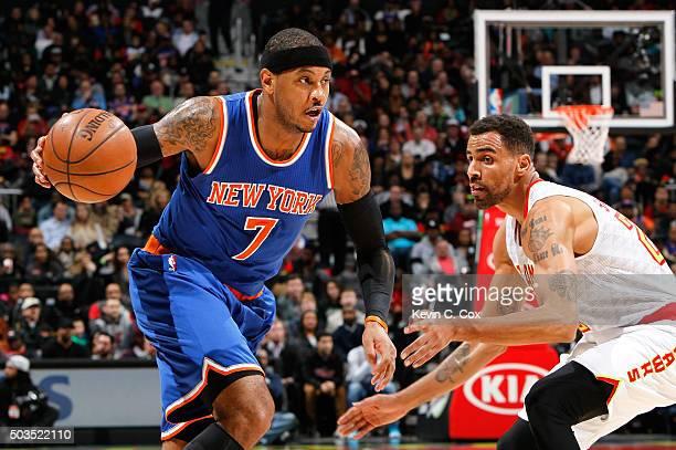 Carmelo Anthony of the New York Knicks drives against Thabo Sefolosha of the Atlanta Hawks at Philips Arena on January 5 2016 in Atlanta Georgia NOTE...