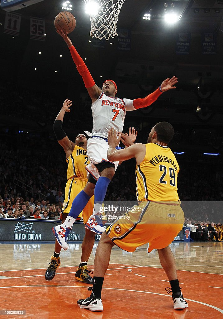 Carmelo Anthony #7 of the New York Knicks drives between Jeff Pendergraph #29 and David West #21 of the Indiana Pacers during Game Two of the Eastern Conference Semifinals of the 2013 NBA Playoffs at Madison Square Garden on May 7, 2013 in New York City.