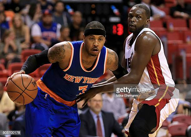 Carmelo Anthony of the New York Knicks drives on Luol Deng of the Miami Heat during a game at American Airlines Arena on January 6 2016 in Miami...