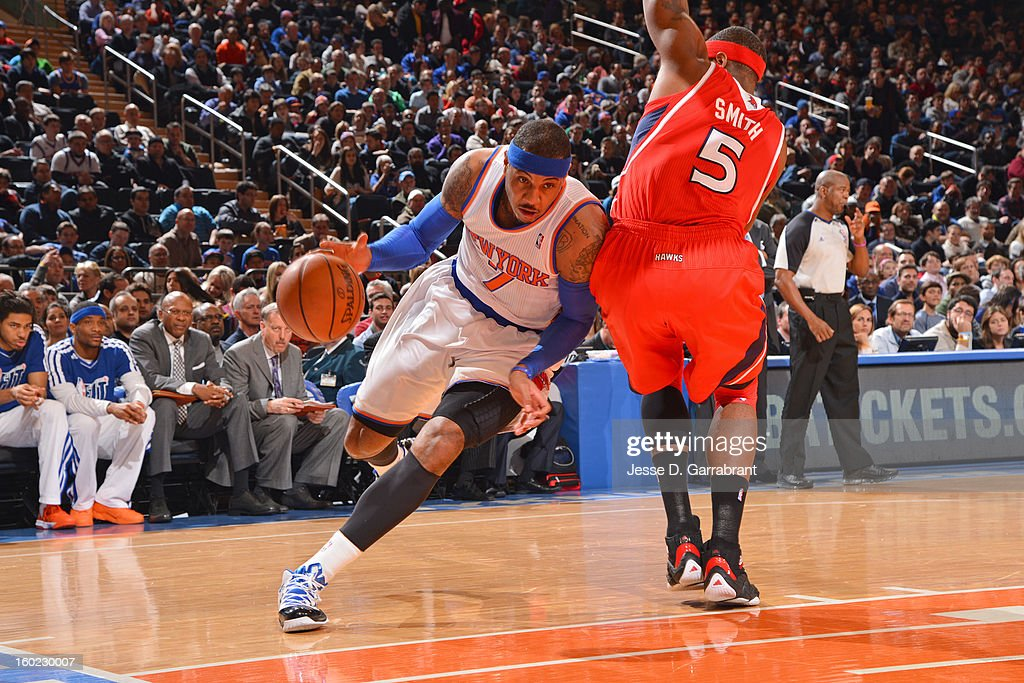 Carmelo Anthony #7 of the New York Knicks drives to the basket against Anthony Tolliver #4 of the Atlanta Hawks at Madison Square Garden on January 27, 2013 in New York, New York.