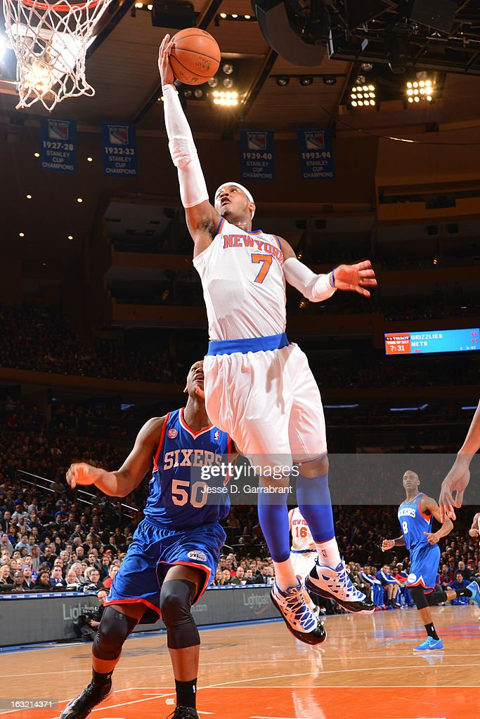 Carmelo Anthony #7 of the New York Knicks drives to the basket against the Philadelphia 76ers on February 24, 2013 at Madison Square Garden in New York City, New York.