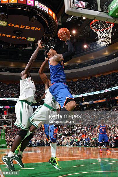 Carmelo Anthony of the New York Knicks drives to the basket against the Boston Celtics in Game Four of the Eastern Conference Quarterfinals during...