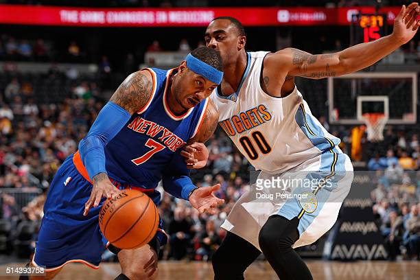 Carmelo Anthony of the New York Knicks drives to the basket against Darrell Arthur of the Denver Nuggets at Pepsi Center on March 8 2016 in Denver...