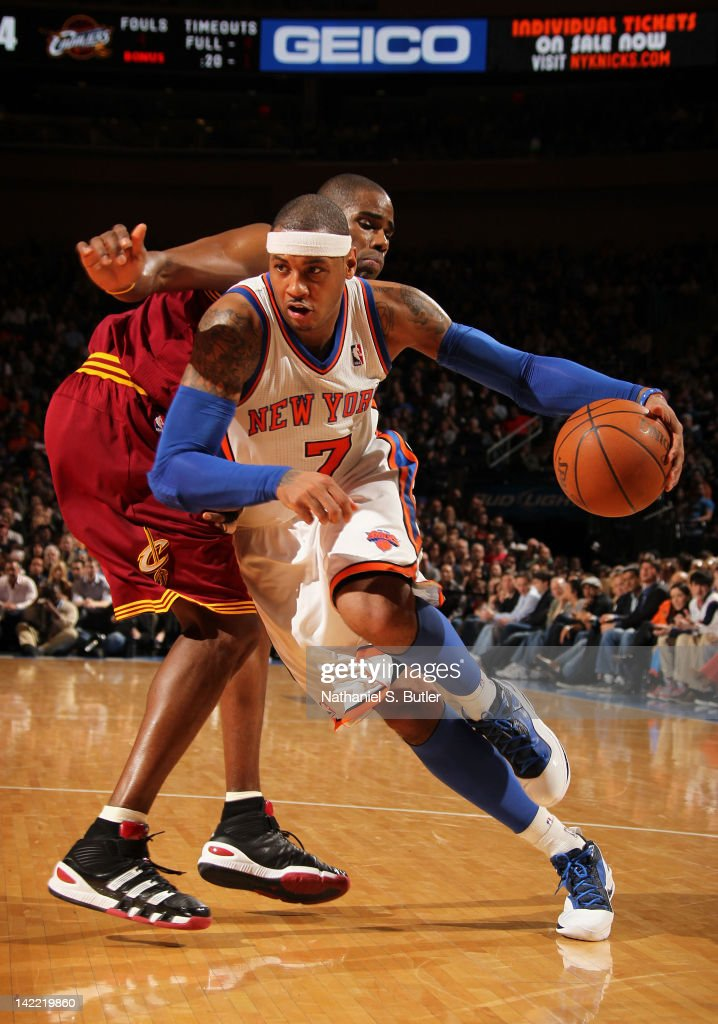 Carmelo Anthony #7 of the New York Knicks drives to the basket around Antawn Jamison #4 of the Cleveland Cavaliers during the game on March 31, 2012 at Madison Square Garden in New York City.