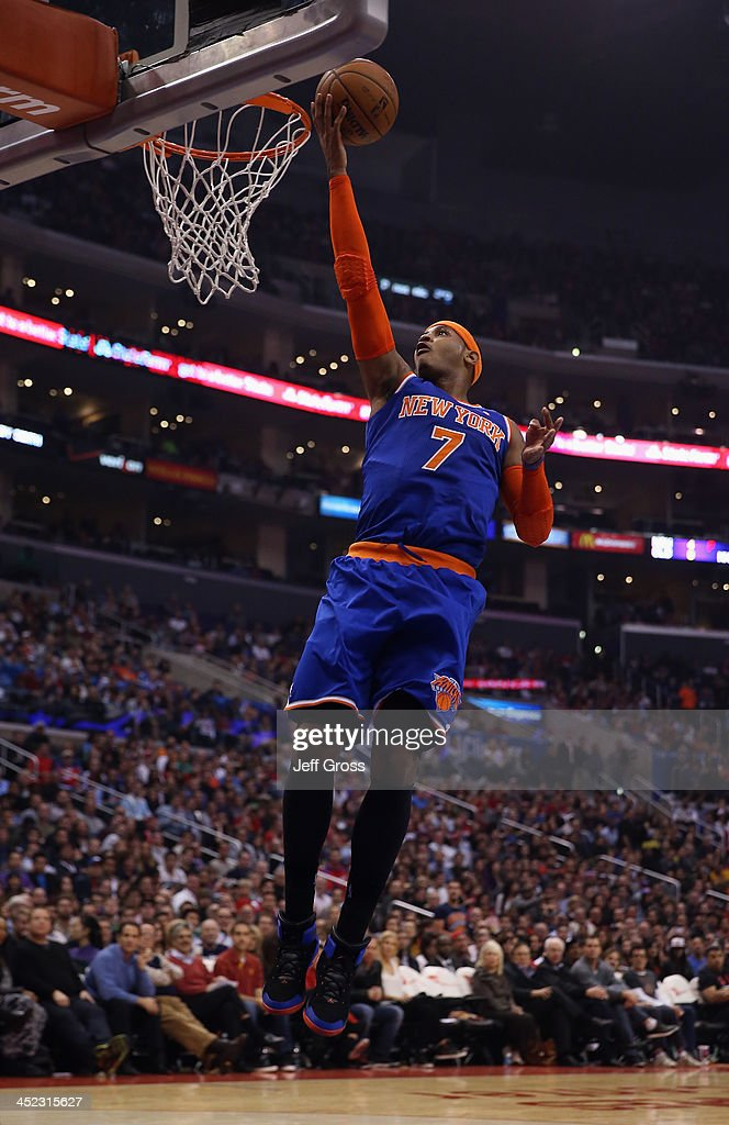 Carmelo Anthony #7 of the New York Knicks drives to the basket for a layup against the Los Angeles Clippers in the first half at Staples Center on November 27, 2013 in Los Angeles, California.