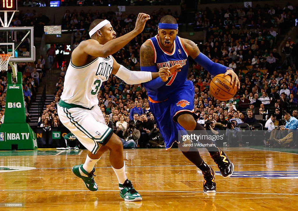 Carmelo Anthony #7 of the New York Knicks drives to the basket in front of Paul Pierce #34 of the Boston Celtics during the game on January 24, 2013 at TD Garden in Boston, Massachusetts.