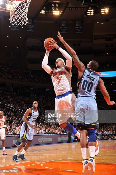 Carmelo Anthony of the New York Knicks drives to the basket on Darrell Arthur of the Memphis Grizzlies on March 27 2013 at Madison Square Garden in...