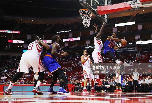Carmelo Anthony of the New York Knicks drives with the basketball against Clint Capela of the Houston Rockets during their game at the Toyota Center...
