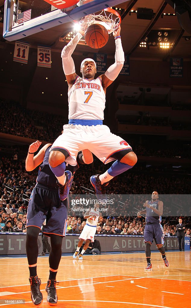 Carmelo Anthony #7 of the New York Knicks dunks against the Charlotte Bobcats on March 29, 2013 at Madison Square Garden in New York City.
