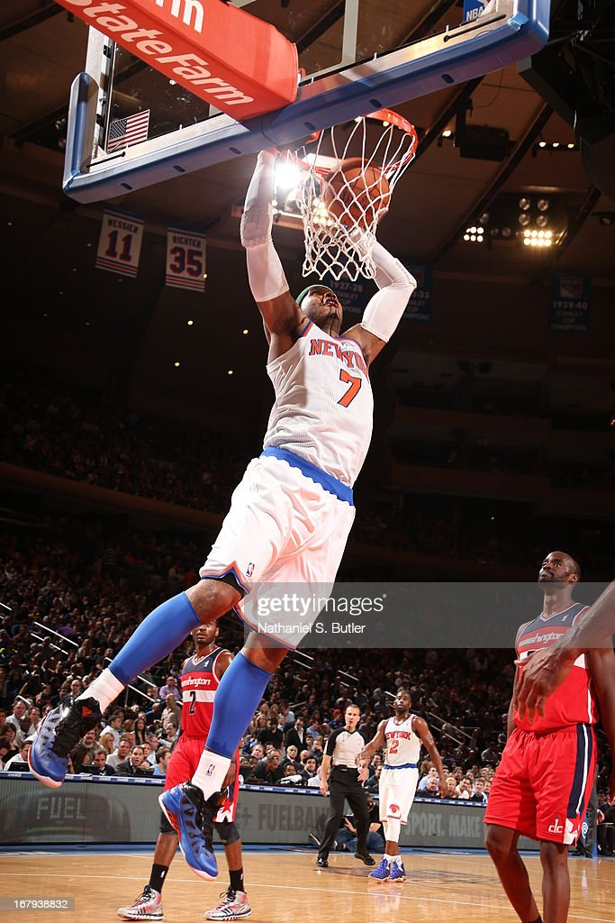 Carmelo Anthony #7 of the New York Knicks dunks against the Washington Wizards on April 9, 2013 at Madison Square Garden in New York City.