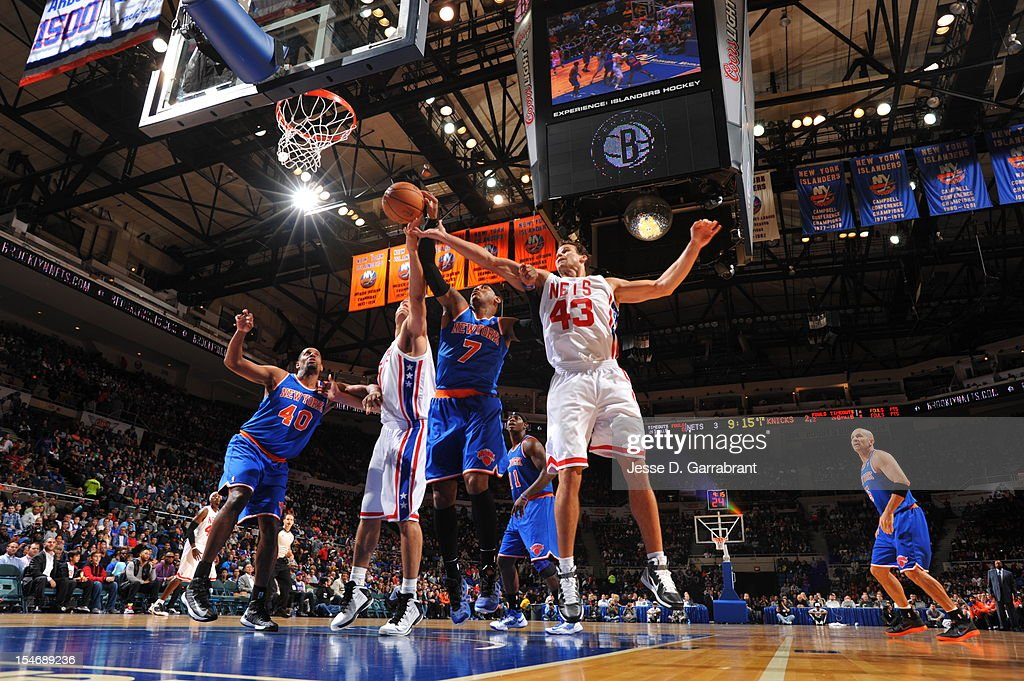 Carmelo Anthony #7 of the New York Knicks fights for the ball against Kris Humphries #43 of the Brooklyn Nets on October 24, 2012 at the Nassau Veterans Memorial Coliseum in Long Island, New York.
