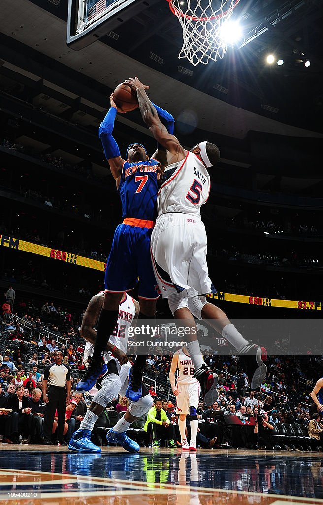 Carmelo Anthony #7 of the New York Knicks gets his shot blocked against Josh Smith #5 of the Atlanta Hawks on April 3, 2013 at Philips Arena in Atlanta, Georgia.