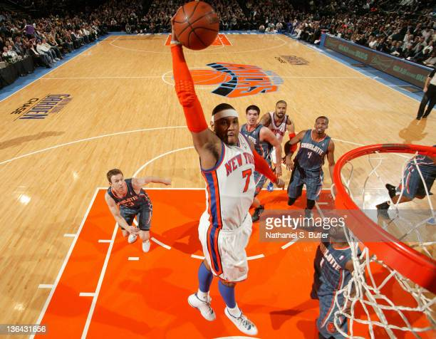 Carmelo Anthony of the New York Knicks goes in for a slam dunk against the Charlotte Bobcats on January 4, 2012 at Madison Square Garden in New York...