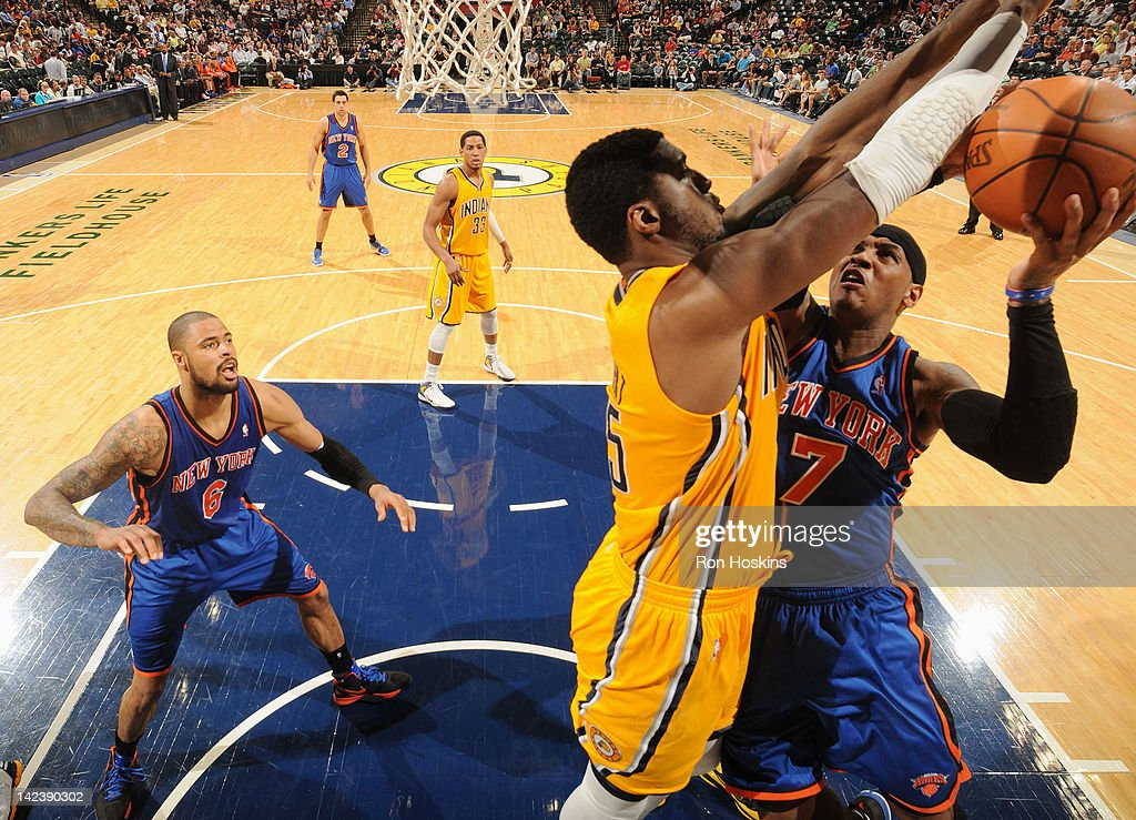 Carmelo Anthony #7 of the New York Knicks goes to the basket against Roy Hibbert #55 of the Indiana Pacers during the game on April 3, 2012 at Bankers Life Fieldhouse in Indianapolis, Indiana.