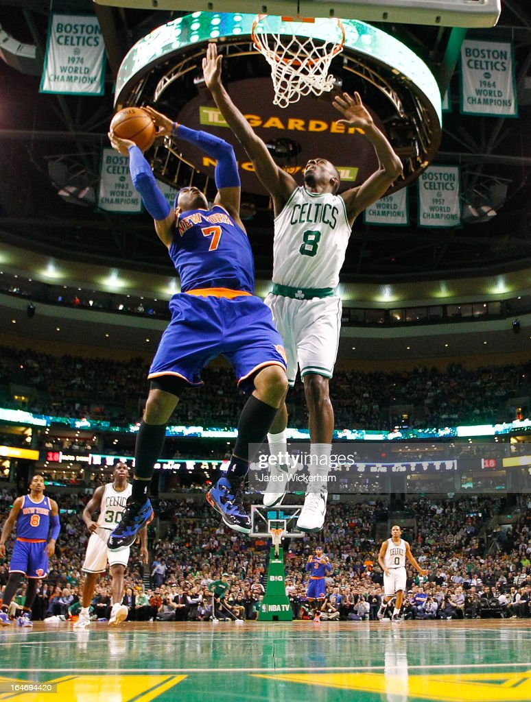 Carmelo Anthony #7 of the New York Knicks goes up for a layup in front of Jeff Green #8 of the Boston Celtics during the game on March 26, 2013 at TD Garden in Boston, Massachusetts.