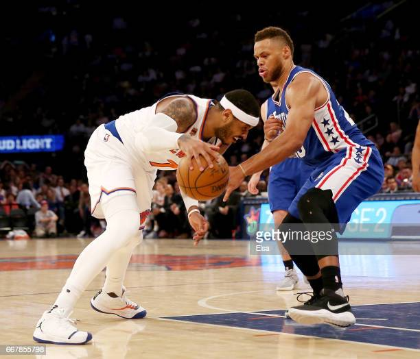 Carmelo Anthony of the New York Knicks heads for the net as Justin Anderson of the Philadelphia 76ers defends in the third quarter at Madison Square...