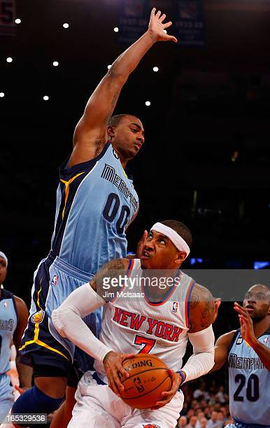 Carmelo Anthony of the New York Knicks in action against Darrell Arthur of the Memphis Grizzlies at Madison Square Garden on March 27 2013 in New...