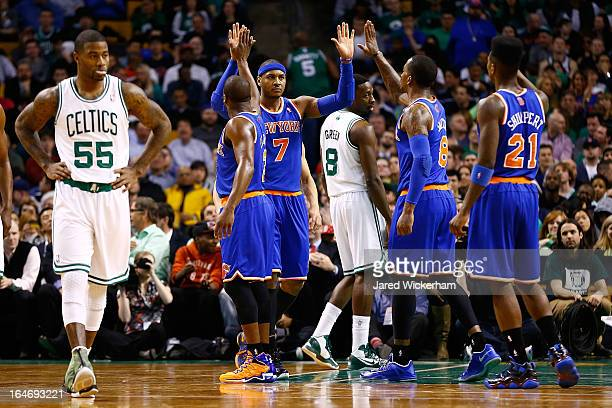 Carmelo Anthony of the New York Knicks is congratulated by teammates after making a shot and being fouled in the second quarter against the Boston...