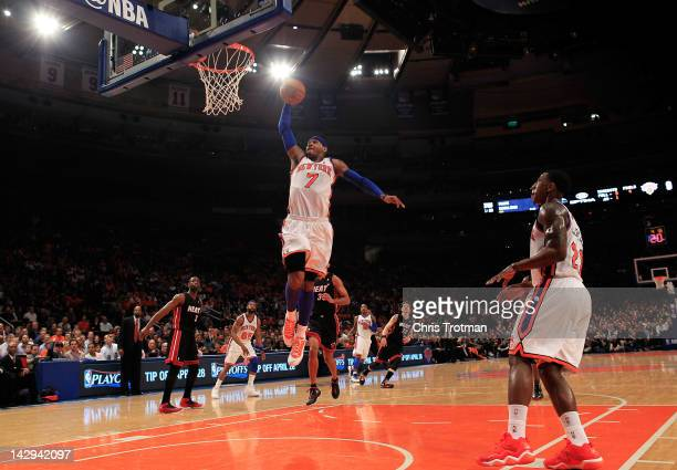 Carmelo Anthony of the New York Knicks lays the ball up against the Miami Heat at Madison Square Garden on April 15 2012 in New York City NOTE TO...