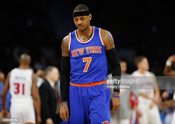 Carmelo Anthony of the New York Knicks leaves the floor for a first half time out while playing the Detroit Pistons at the Palace of Auburn Hills on...