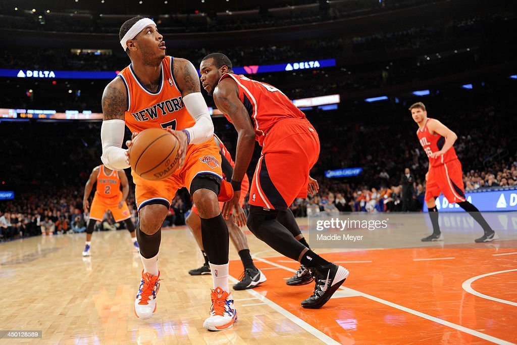 Carmelo Anthony #7 of the New York Knicks looks for a shot over Paul Millsap #4 of the Atlanta Hawks during the second half at Madison Square Garden on November 16, 2013 in New York City. The Hawks defeat the Knicks 110-90.