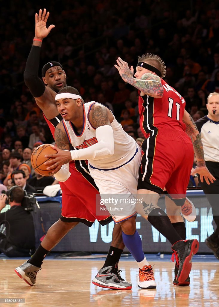 Carmelo Anthony #7 of the New York Knicks passes the ball under pressure from LeBron James #6 and Chris Andersen #11 of the Miami Heat at Madison Square Garden on March 3, 2013 in New York City.NOTE