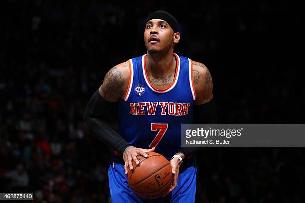 Carmelo Anthony of the New York Knicks prepares to shoot a free throw against the Brooklyn Nets on February 6 2015 at the Barclays Center in the...