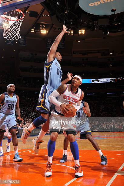 Carmelo Anthony of the New York Knicks protects the ball from Darrell Arthur of the Memphis Grizzlies during the game between the Memphis Grizzlies...