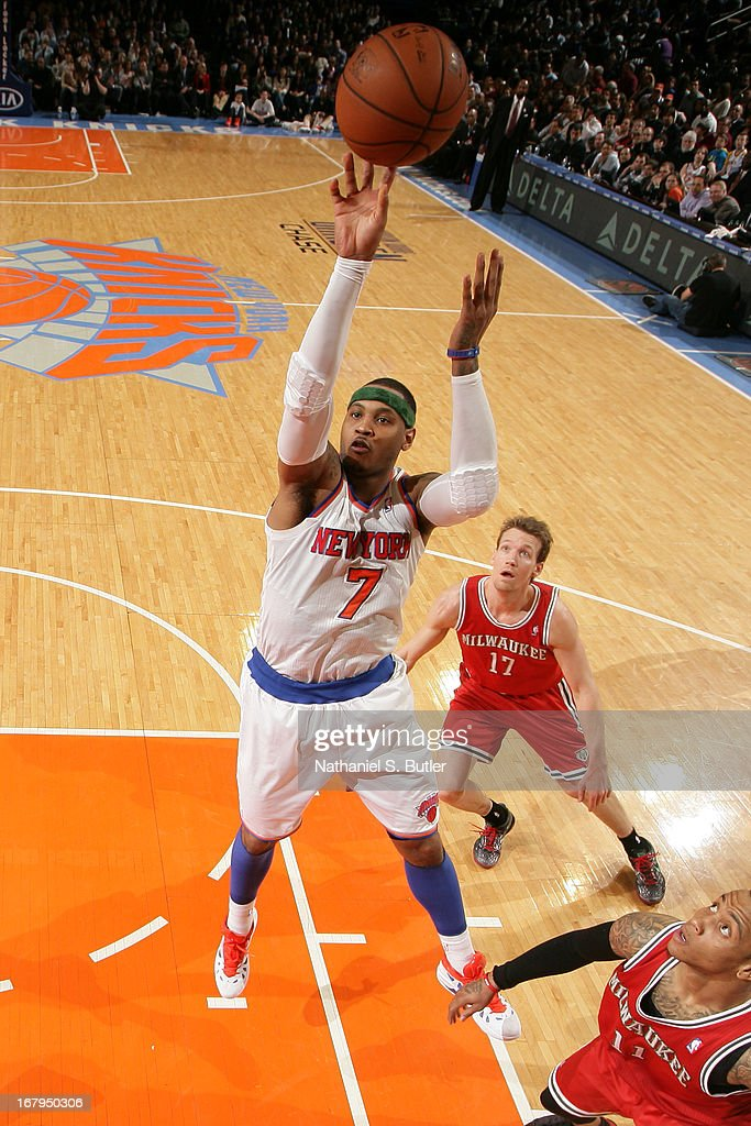 Carmelo Anthony #7 of the New York Knicks puts up a shot against the Milwaukee Bucks on April 5, 2013 at Madison Square Garden in New York City.