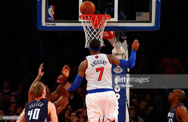 Carmelo Anthony of the New York Knicks puts up a shot for his 62nd point of a game against the Charlotte Bobcats at Madison Square Garden on January...