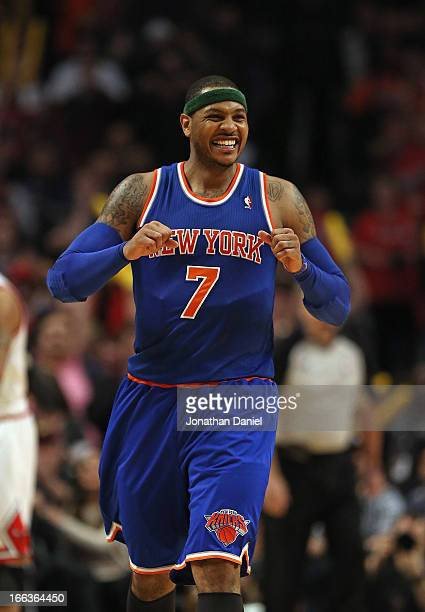 Carmelo Anthony of the New York Knicks reacts after missing a shot in the last second of regulation against the Chicago Bulls at the United Center on...