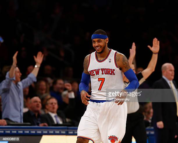 Carmelo Anthony of the New York Knicks reacts during his game where he scored 62 points against the Charlotte Bobcats at Madison Square Garden...