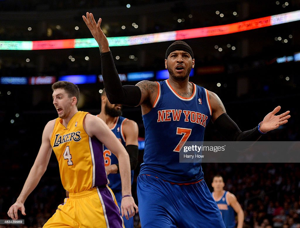Carmelo Anthony #7 of the New York Knicks reacts for a foul in front of Ryan Kelly #4 of the Los Angeles Lakers during the game at Staples Center on March 25, 2014 in Los Angeles, California.