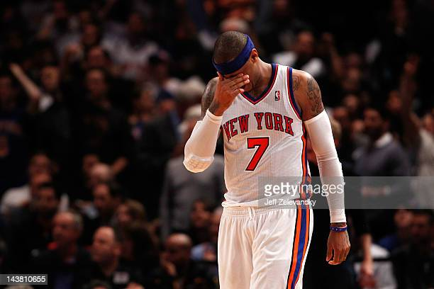 Carmelo Anthony of the New York Knicks reacts in the fourth quarter against the Miami Heat in Game Three of the Eastern Conference Quarterfinals in...