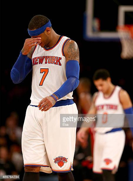 Carmelo Anthony of the New York Knicks reacts in the fourth quarter against the Miami Heat at Madison Square Garden on November 30 2014 in New York...