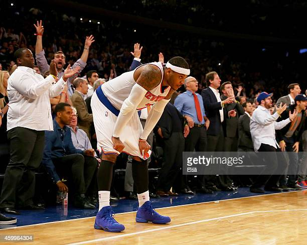 Carmelo Anthony of the New York Knicks reacts to the loss as the Cleveland Cavaliers win at Madison Square Garden on December 4 2014 in New York...