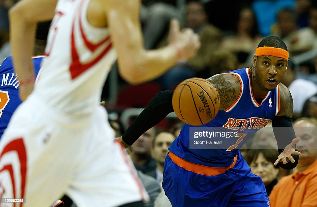 Carmelo Anthony #7 of the New York Knicks runs upcourt with the ball against the Houston Rockets at the Toyota Center on November 23, 2012 in Houston, Texas.