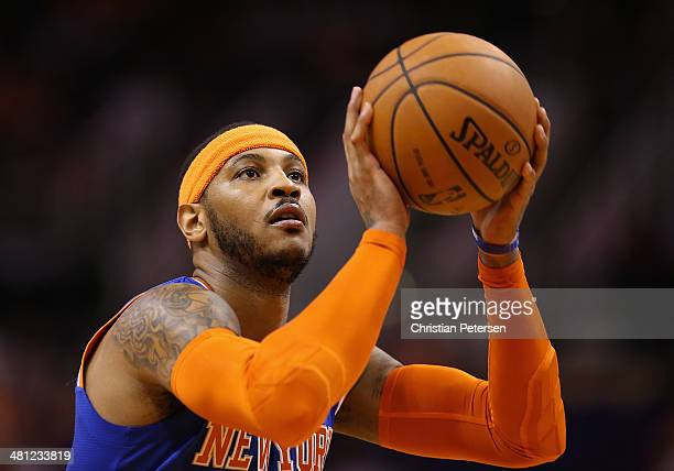 Carmelo Anthony of the New York Knicks shoots a free throw shot against the Phoenix Suns during the NBA game at US Airways Center on March 28 2014 in...