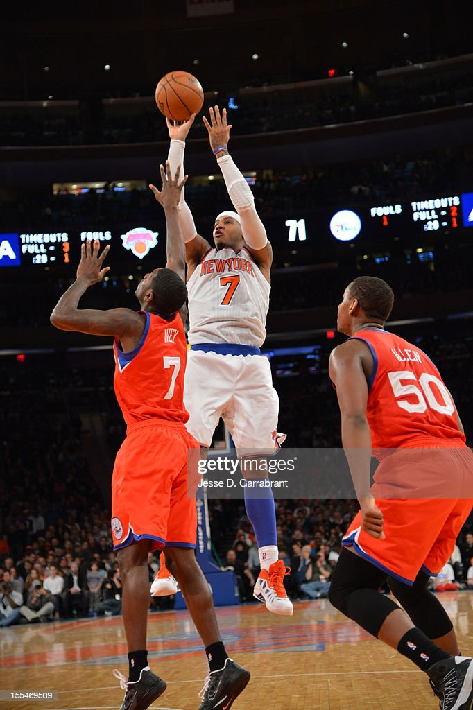 Carmelo Anthony #7 of the New York Knicks shoots a jumper against Royal Ivey #7 of the Philadelphia 76ers on November 4, 2012 at Madison Square Garden in New York City.