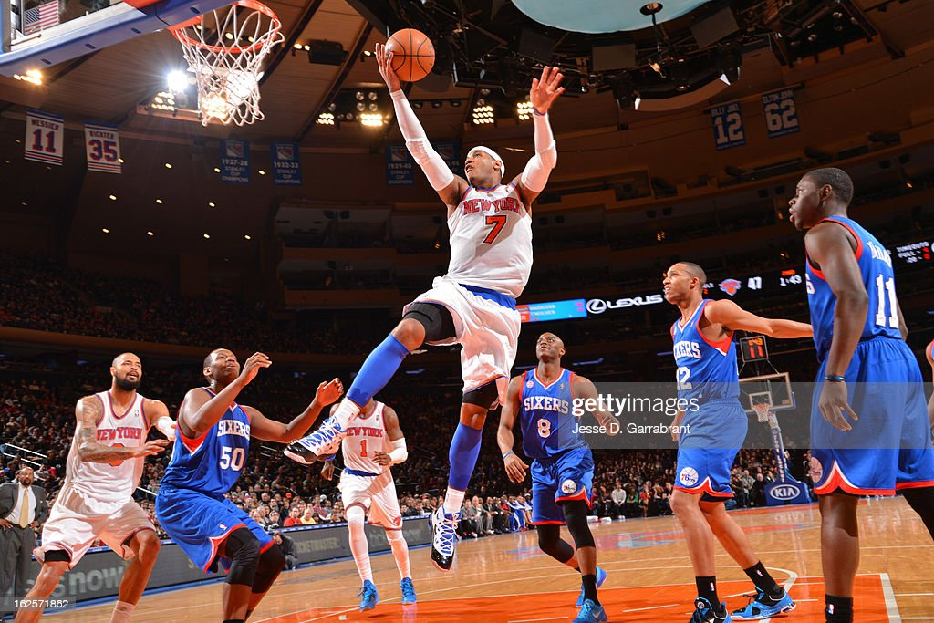 Carmelo Anthony #7 of the New York Knicks shoots a layup against the Philadelphia 76ers on February 24, 2013 at Madison Square Garden in New York City, New York.