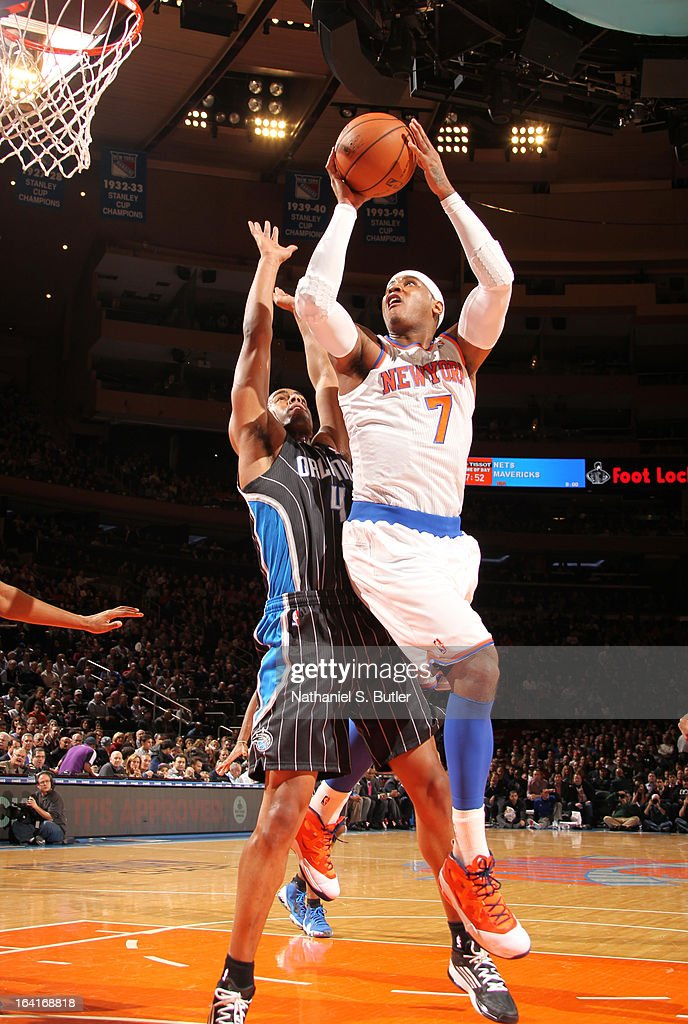 Carmelo Anthony #7 of the New York Knicks shoots against Arron Afflalo #4 of the Orlando Magic on March 20, 2013 at Madison Square Garden in New York City.