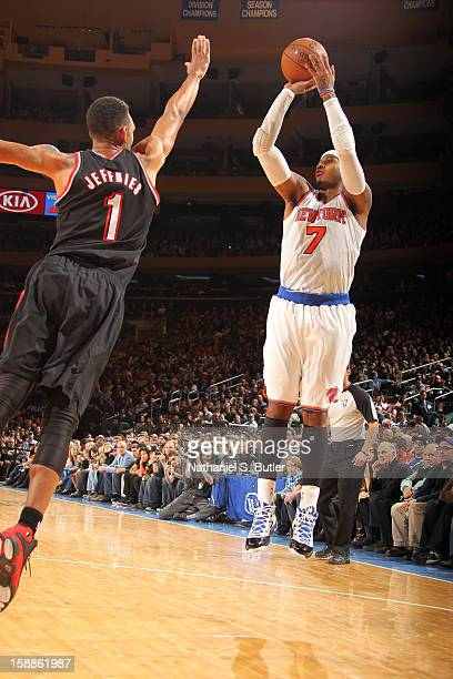 Carmelo Anthony of the New York Knicks shoots against Jared Jeffries of the Portland Trail Blazers on January 1 2013 at Madison Square Garden in New...