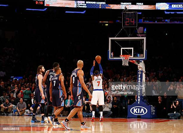 Carmelo Anthony of the New York Knicks shoots during his game where he scored 62 points against the Charlotte Bobcats at Madison Square Garden...