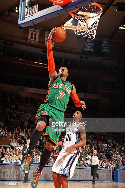 Carmelo Anthony of the New York Knicks shoots over Darrell Arthur of the Memphis Grizzlies on March 17 2011 at Madison Square Garden in New York City...