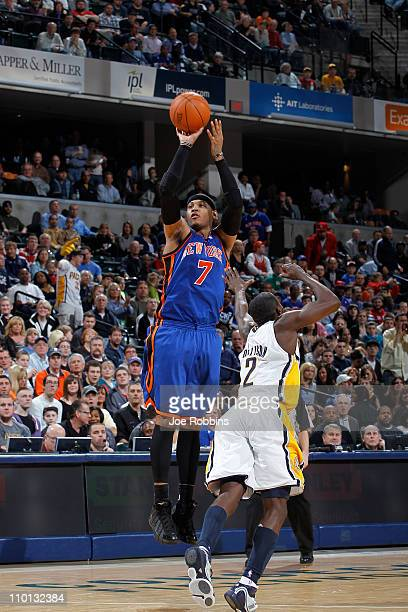 Carmelo Anthony of the New York Knicks shoots over Darren Collison of the Indiana Pacers on March 15 2011 at Conseco Fieldhouse in Indianapolis...