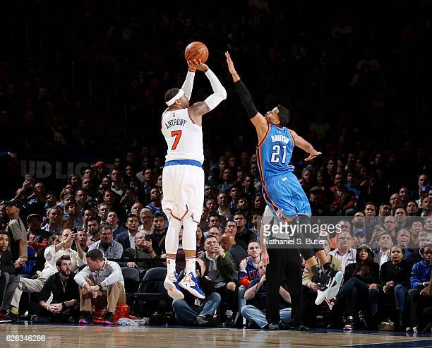 Carmelo Anthony of the New York Knicks shoots the ball against Andre Roberson of the Oklahoma City Thunder during the game on November 28 2016 at...