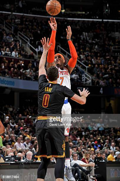 Carmelo Anthony of the New York Knicks shoots the ball over Kevin Love of the Cleveland Cavaliers on October 25 2016 at Quicken Loans Arena in...
