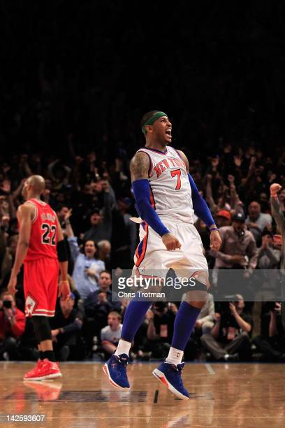 Carmelo Anthony of the New York Knicks shoots the game game tying three pointer in the fourth quarter as Taj Gibson of the Chicago Bulls looks on at...