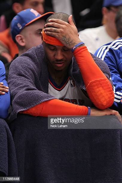 Carmelo Anthony of the New York Knicks sits on the bench dejected late in the second half against the Boston Celtics in Game Three of the Eastern...