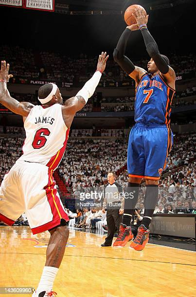 Carmelo anthony jumpshot getty images carmelo anthony of the new york knicks takes a jump shot over lebron james of the voltagebd Choice Image